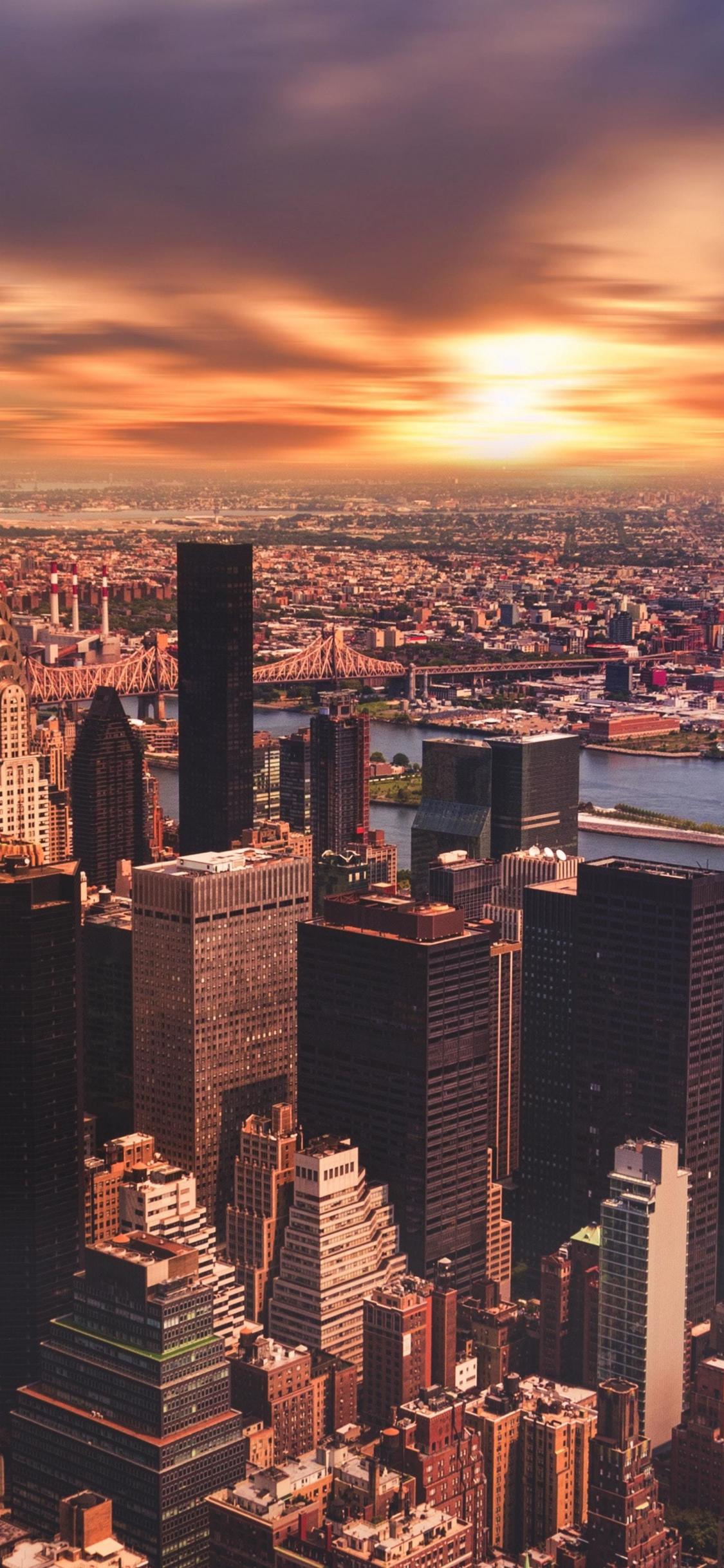 Download 1125x2436 Wallpaper New York Skysrapers Cityscape Sunset