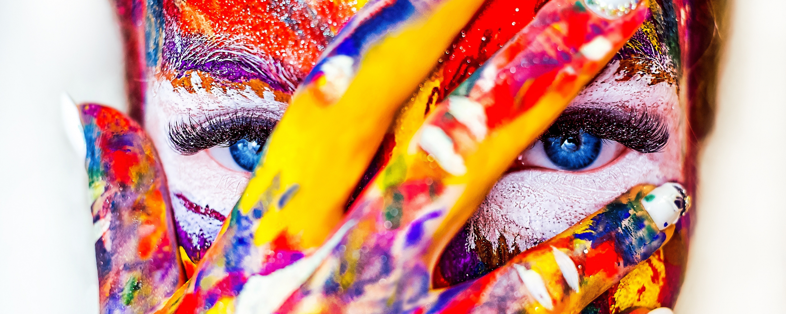 Paint on face and hand, colorful, close up, 2560x1024 wallpaper