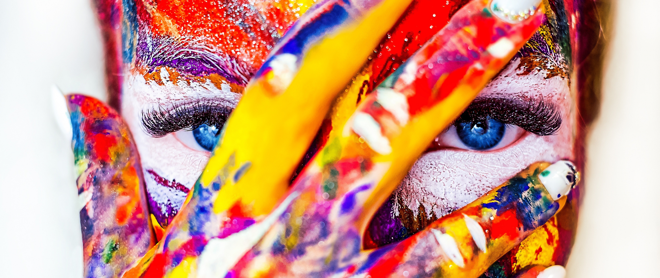 Paint on face and hand, colorful, close up, 2560x1080 wallpaper