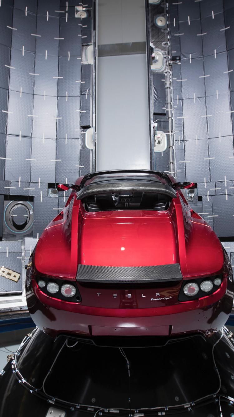 download 750x1334 wallpaper tesla roadster, red car, rocket, iphone