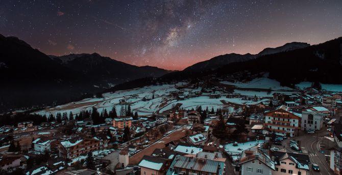 Winter city aerial view milky way night
