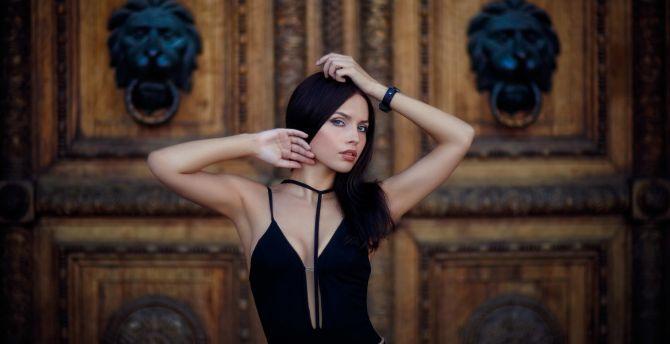 Girl model black dress arms up