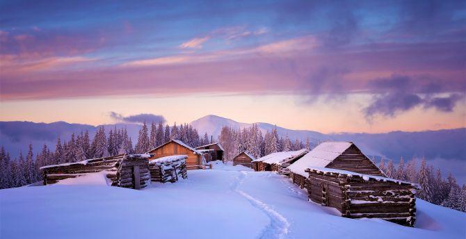Houses winter landscape sunst
