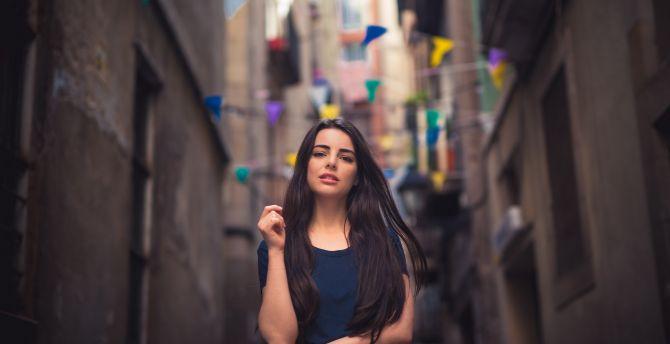 Beautiful brunette girl at street