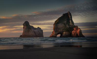 New zealand beach arc cliff