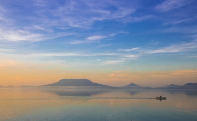 Fishing boat lake mountains sky minimal
