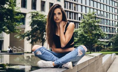Brunette girl model teared jeans