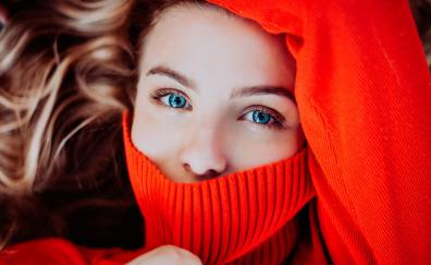 Red sweater woman blue eyes