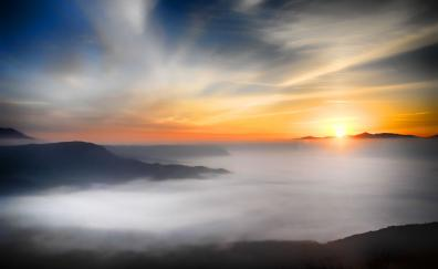 Sea clouds mountains sunset