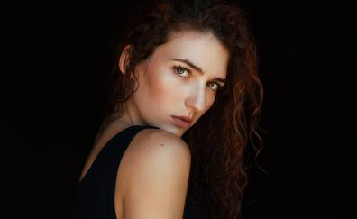 Beautiful woman red head curly hair