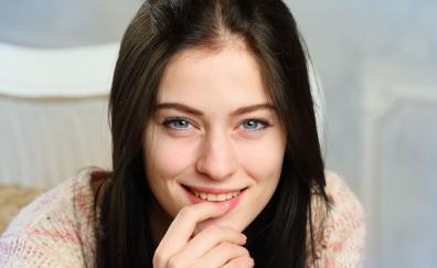Finger on lips smile beautiful model