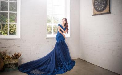 Asian woman blue dress