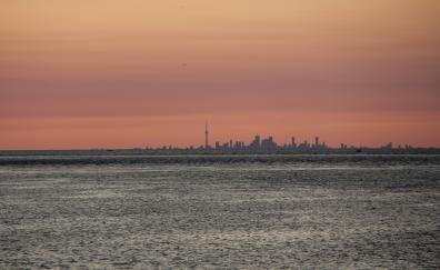 Sunset sea sky city