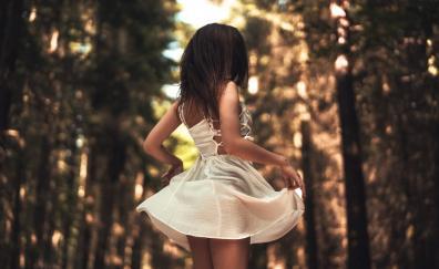 Woman outdoor white dress jump