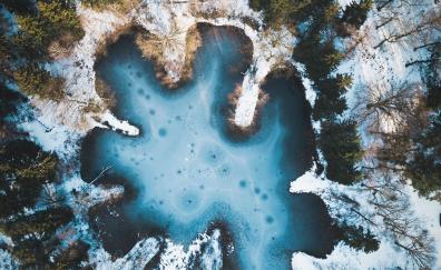 Pond winter snow aerial view